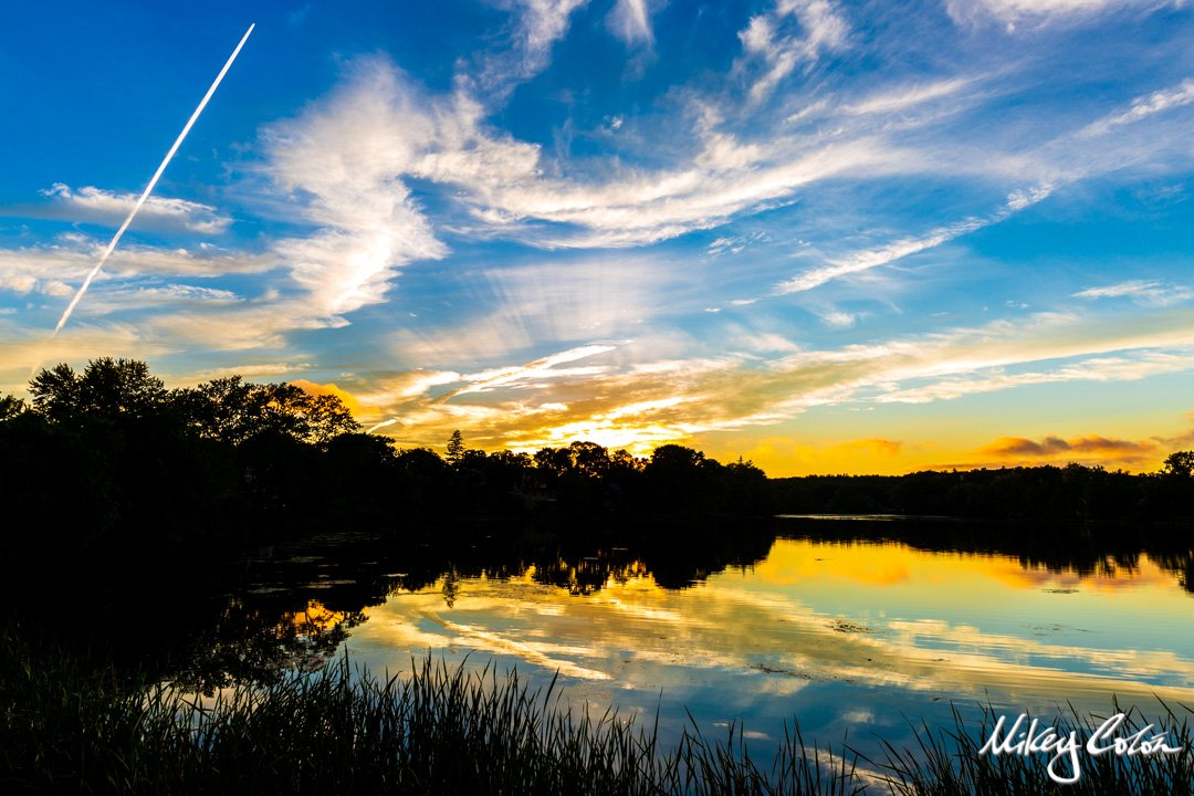 Ell Pond is located in New England - Melrose Massachusetts. The pond offers stunning photo opportunities for sunsets.